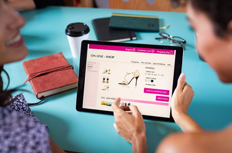 women doing online shopping on digital tablet